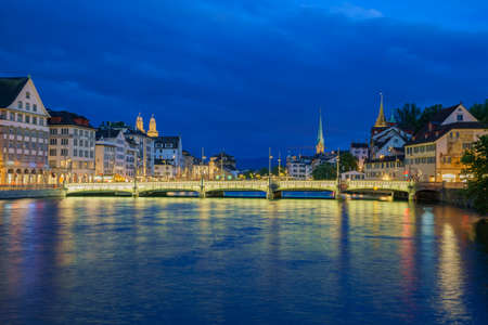 Night cityscape with Limmat river of the historical Zurich city, Switzerland