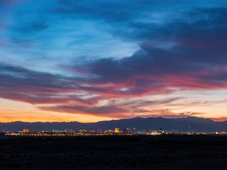 Sunset view of the beautiful strip skyline with red clouds at Las Vegas, Nevada