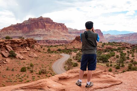 Photographer taking picture of the Beautiful landscape around the Panorama Point of Capitol Reef National Park at Utah