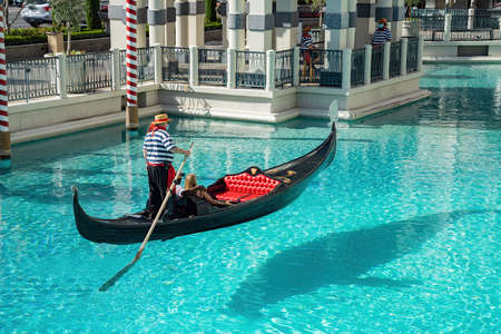 Las Vegas, JUN 30, 2020 -People playing Gondola with face mask