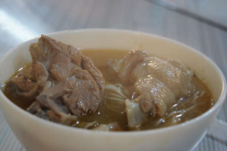 Close up shot of delicious sesame oil chicken soup with noodles at Taipei, Taiwan