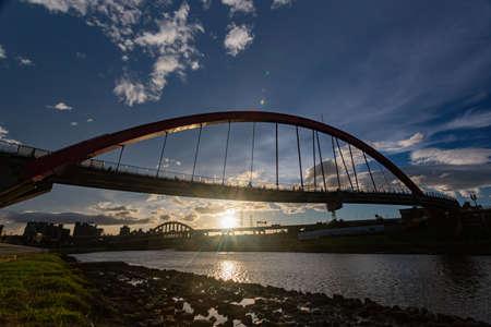Sunset view of the beautiful Rainbow Bridge at Taipei, Taiwan