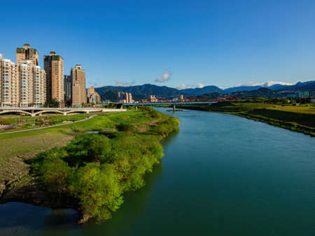 Afternoon view of the river cityscape of Xindian District area at Taipei