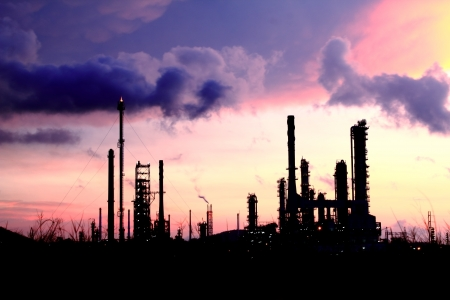 Silhouettes of Petrochemical refineries. Stock Photo