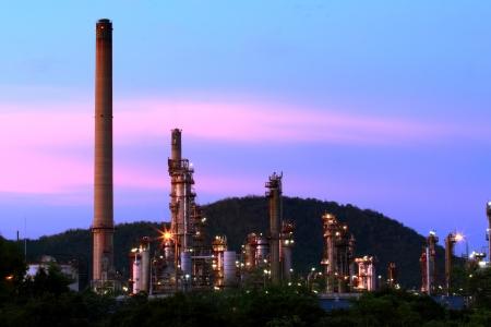 Oil refinery at sunrise Chonburi, Thailand Stock Photo