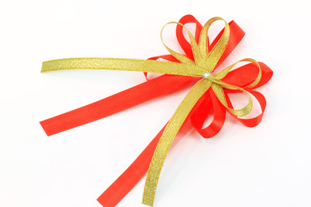 red ribbon and bow on white paper background