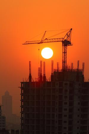 Large Crane Building in Bangkok at sunset