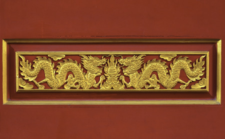 Double Dragon in gold on a red background  photo