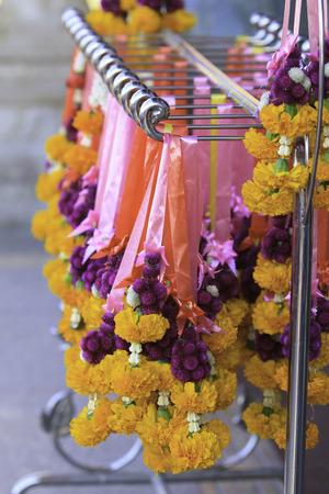 Marigold garlands in flower market in Thailand photo