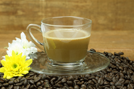 Coffee cup and saucer on a wooden table background. Stock Photo