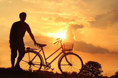 beautiful landscape image with Bicycle silhouette at sunset photo