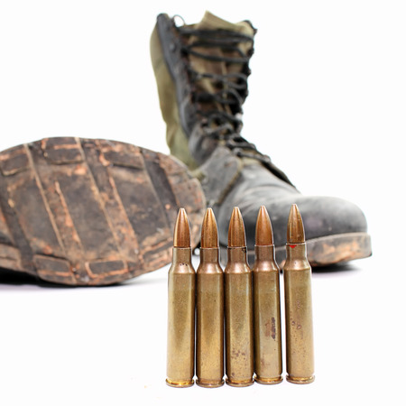 Old army boots, and 5.56 mm ammunition separate from the white .