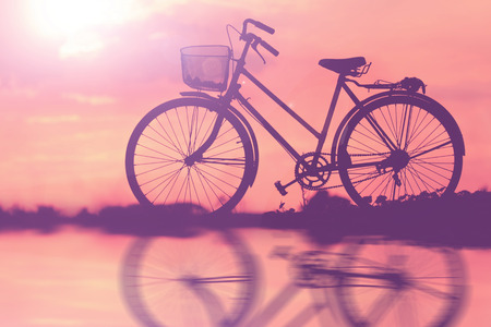 Bicycle parking silhouette sunset. photo