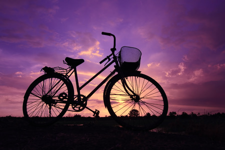beautiful landscape  Bicycle silhouette at sunset Stock Photo