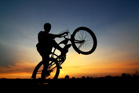 spring break: Bicycle parking silhouette sunset.