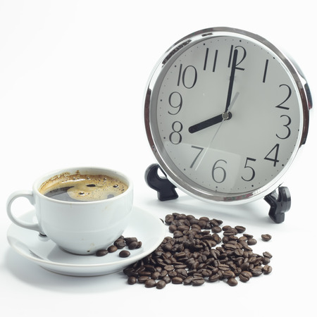 cup of coffee, coffee grains, clock Stock Photo