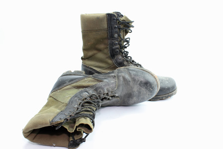 Old  combat boots isolated on white .