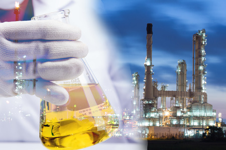 Oil in lap on industry background. Stock Photo