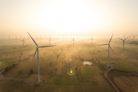 Aerial view of wind turbine . Sustainable development, environment friendly, renewable energy concept. Фото со стока