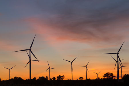 wind turbine sunset . Sustainable development, environment friendly, renewable energy concept. Banco de Imagens