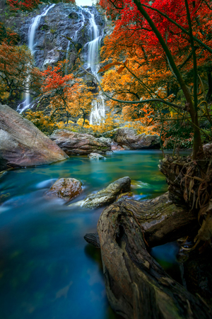 Beautiful Khlong Lan waterfall  autumn forest  Kamphaeng Phet Province. Khlong Lan National Park, Thailand