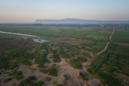 Aerial view Agriculture along the Mekong River at sunrise in Thailand Banco de Imagens