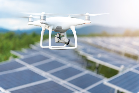 Drones flying over solar cells.Survey concept Stock Photo