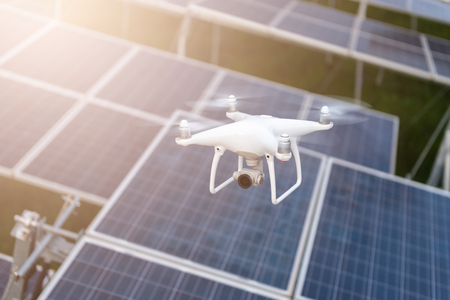 Drones flying over solar cells.Survey concept Stock Photo - 123165435