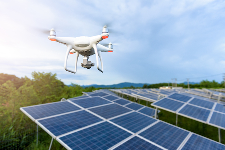 Drones flying over solar cells Stock Photo