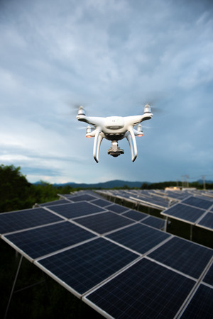 Drones flying over solar cells.Survey concept 写真素材
