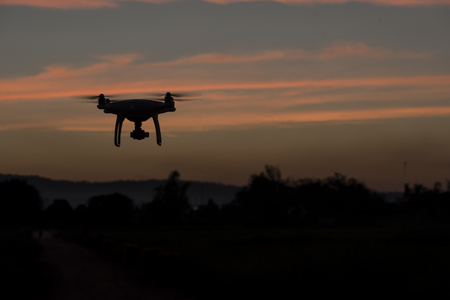 Flying drone above the professional camera takes pictures of the Sky Stock Photo