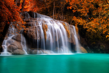 Beautiful Waterfall in autumn forest Art concept at Erawan National Park, Thailand Фото со стока