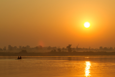 Fisherman at the Mekong River at sunrise