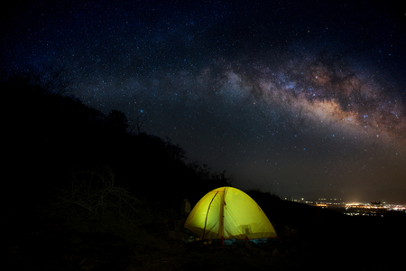 The Milky Way  on Mountain Yellow Camping Tent   in Thailand