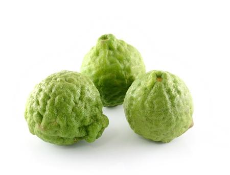 Kaffir lime on white background photo