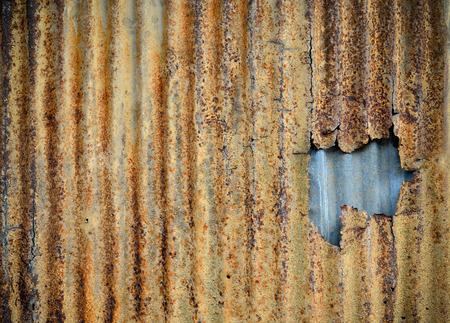 corrugated: Rusty corrugated metal wall