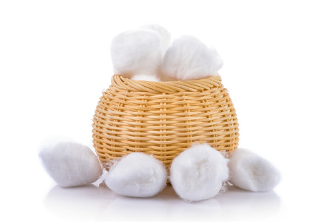cotton wools in basket on a white background