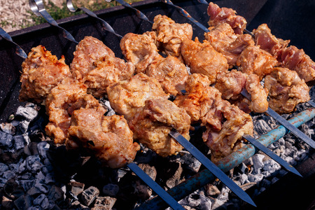 bar b que: pork kebabs grilling at nature