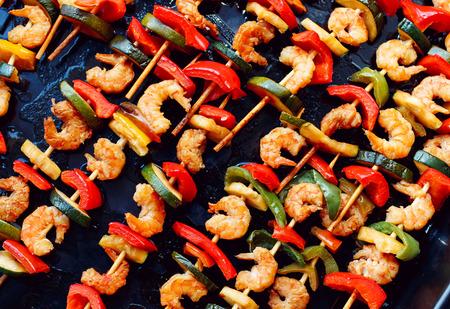 diagonally: shrimp kebabs on baking, diagonally Stock Photo
