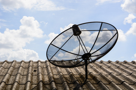 satellite dish on the roof with blue sky Stock Photo