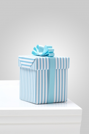 blue striped pattern gift box on white table Gift boxes with blue ribbon