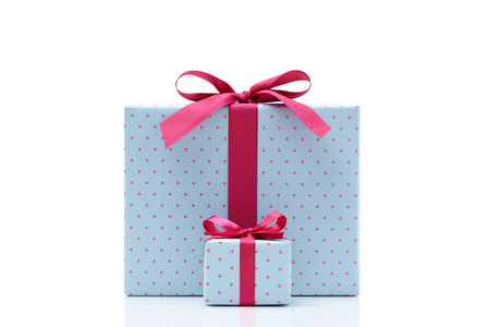 white box: blue gift box on white background Different sizes of the same shape gift box A small gift box with a big gift box