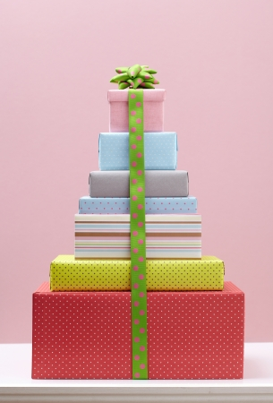boxs: colored gift boxs with decorative bows on white table Group of presents Gift boxs with origami bows  Stock Photo