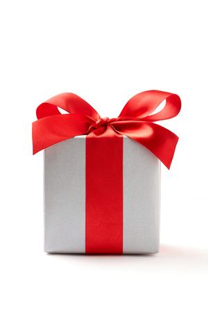 silver ribbon: silver gift box on white background.  silver Gift box with red ribbon.