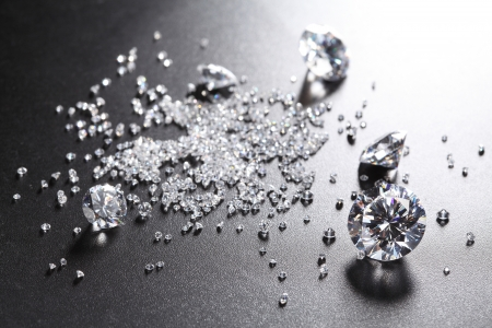 diamond stones: cut diamonds on shiny black surface Stock Photo