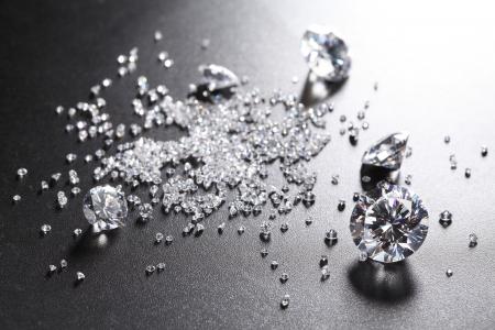 cut diamonds on shiny black surface Standard-Bild