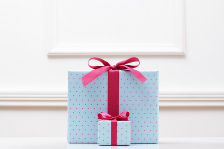 blue gift box on white table. Different sizes of the same shape gift box. A small gift box with a big gift box.  Stock Photo
