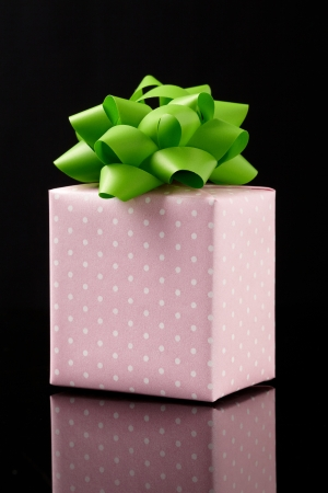 gift box on black background.  Group of presents. Gift box with origami bows.