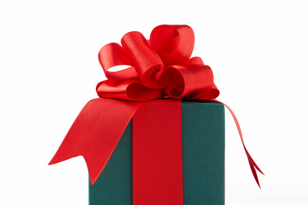 green gift box on white background.  green Gift box with red ribbon.