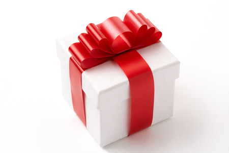 white gift box on white background.  white Gift box with red ribbon.